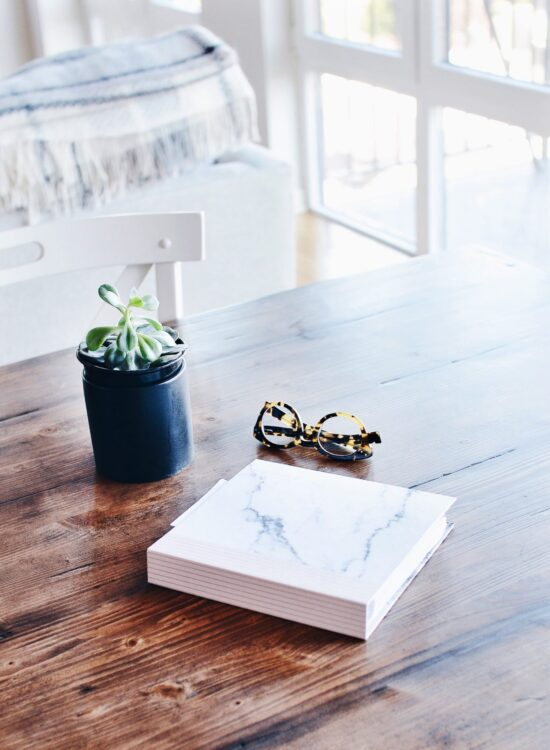 Books On A Table With Plant