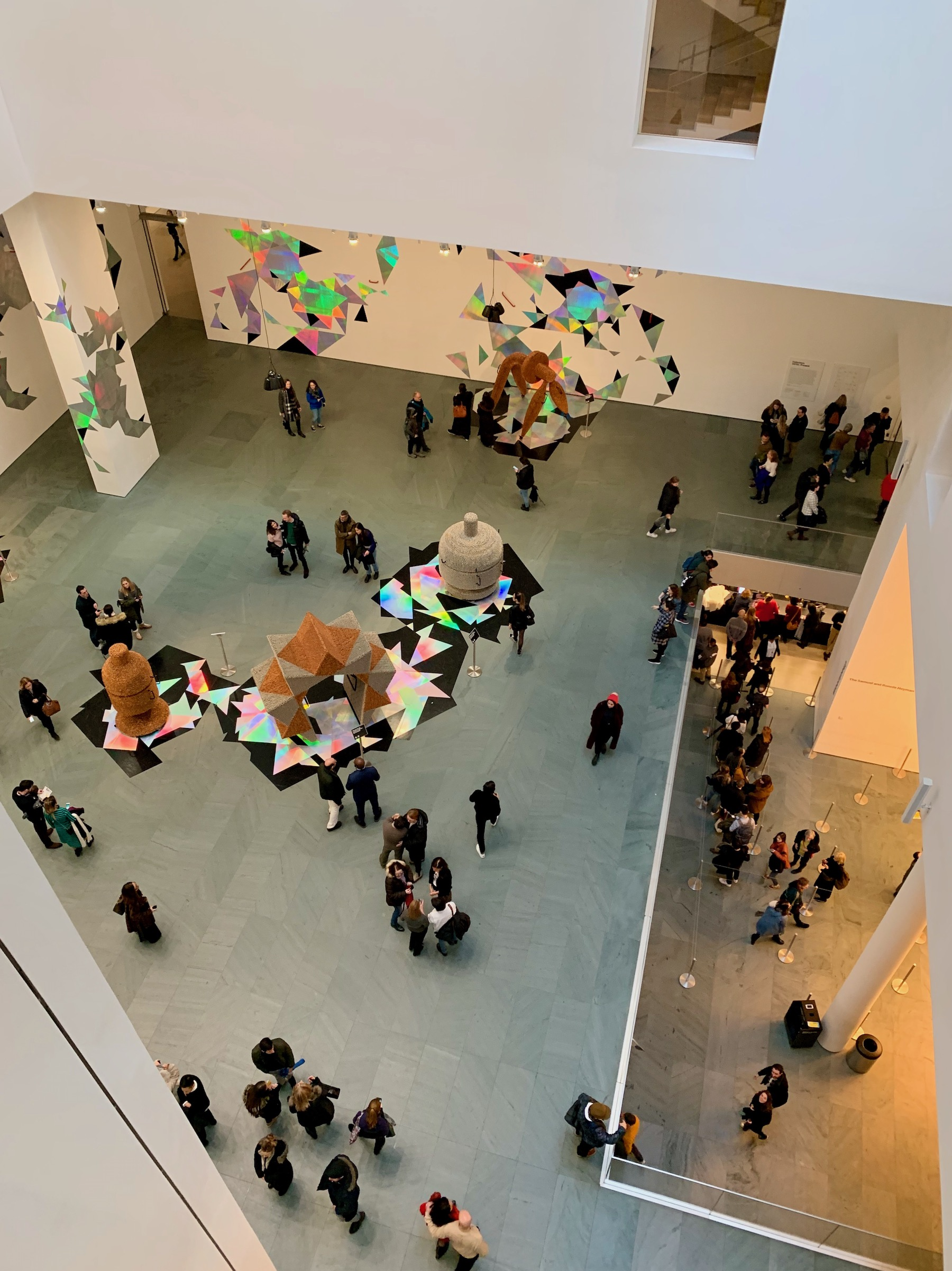 People milling around the lobby at MoMa. The weekender.